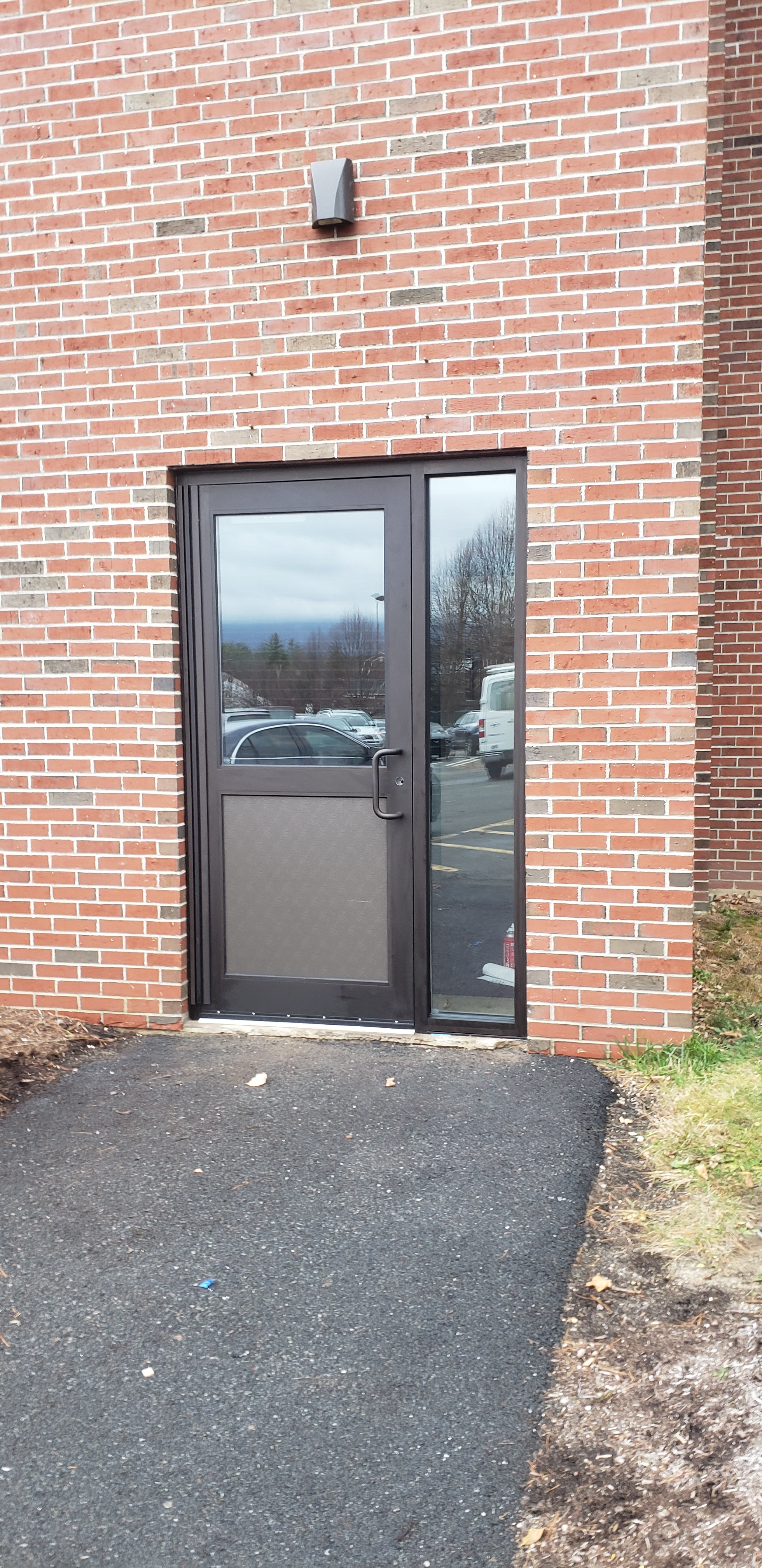 Entrance, side lite and closer installed at a school.