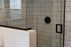 Shower enclosure with side lights.  Bronze hardware.