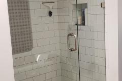 Shower enclosure designed for sloped ceiling in bathroom